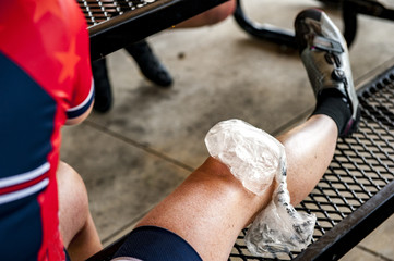 A bag of ice on a woman's knee during a break from a bike ride.