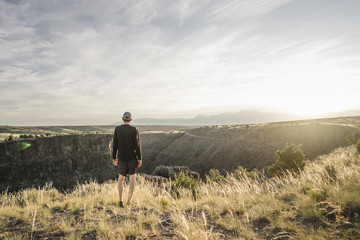 Man looking at view of Rio Grande Gorge, Taos, New Mexico, USA