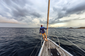 Man standing on bow of yacht, Lombok, Indonesia