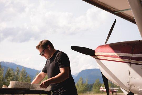 Mechanic working at aerospace hangar