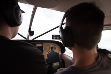 Pilots taking selfie with mobile phone while flying