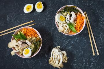 Miso Ramen Asian noodles in bowls on dark stone background