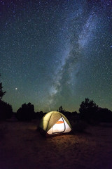Camping night scene with tent and mesa in the Arizona Desert, USA.