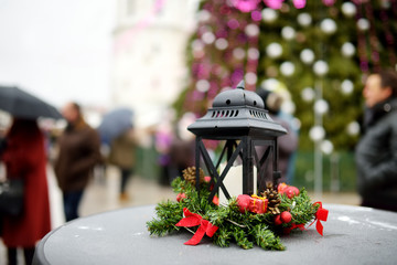 Lantern as a decoration of a wooden table on Christmas market in Vilnius, Lithuania.