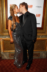 Actor Chris Zylka kisses his girlfriend Paris Hilton as he arrives for the world premiere of The Death and Life of John F. Donovan at the Toronto International Film Festival (TIFF) in Toronto