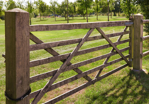 Wooden six bar gate in country park