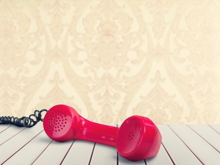 Red telephone receiver  on  background