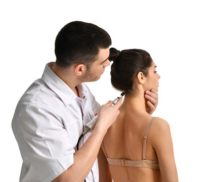 Doctor physician therapist examining  woman neck patient and try to fix her atlas first cervical vertebra