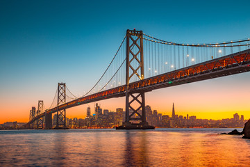 San Francisco skyline with Oakland Bay Bridge at sunset, California, USA