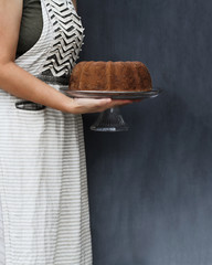 Whole Lemon Bundt Cake Held By Woman