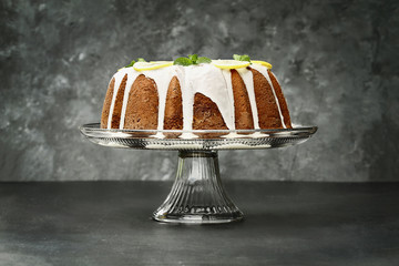 Whole Lemon Bundt Cake in Center of Dark Background