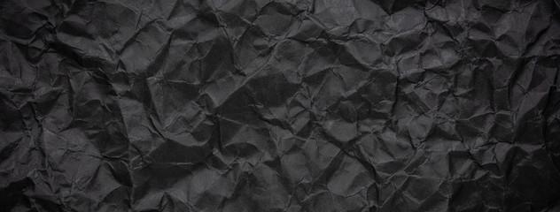 Fototapete - Ragged crumpled dark black paper texture background
