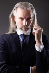 Portrait of old man with grey long hair and beard