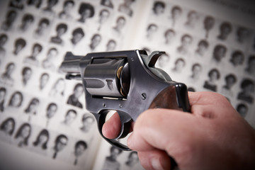 Mass shooting concept with pistol on school yearbook