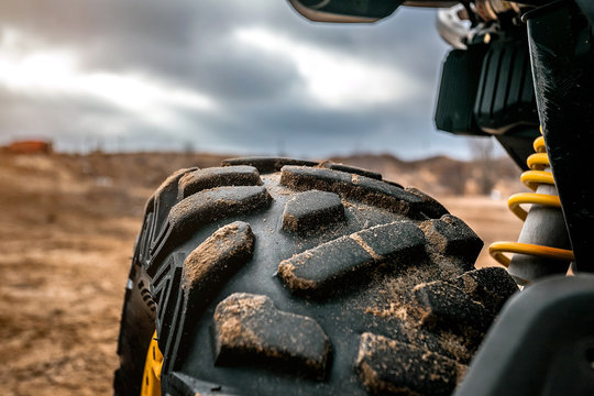 off-road ATV tire protector close-up in contour light, rubber texture