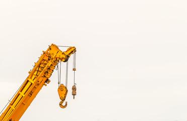 yellow crane hook construction tool