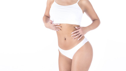 Female body in white lingerie on it isolated on white. Fat lose, liposuction and cellulite removal concept