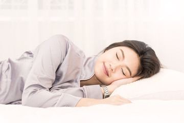 Beautiful Attractive Asian woman sleep and sweet dream on bed in bedroom in the morning feeling so relax and comfortable,Healthcare Concept