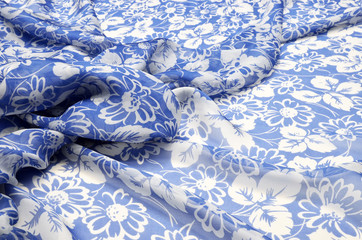 Silk fabric, chiffon in a large floral ornament on a blue