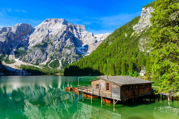 Lake Braies (also known as Pragser Wildsee or Lago di Braies) in Dolomites Mountains, Sudtirol, Italy. Romantic place with typical wooden boats on the alpine lake.  Hiking travel and adventure.  Wall mural