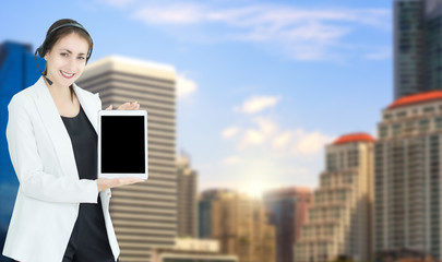 Mix image.Business woman holding smartphone in hand with background city view.