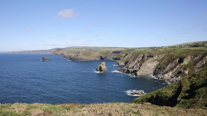 Fototapete - North Cornwall coast view towards Boscastle from Tintagel beautiful blue sea and sky