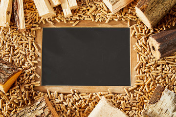 Blackboard surrounded by frame and small pegs