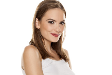 Portrait of young beautiful woman with makeup on white backgeound