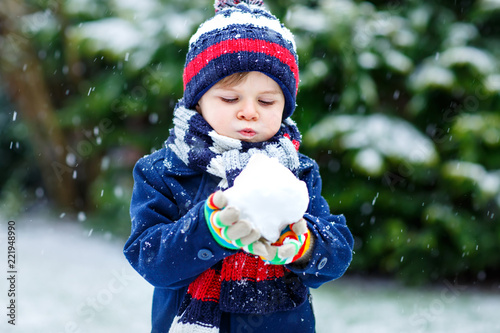 8ca7211c2 Cute little funny child in colorful winter fashion clothes having ...