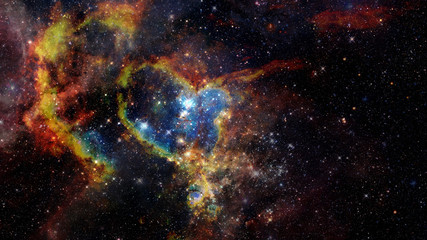 Dark nebula and stars in space. Elements of this image furnished by NASA.