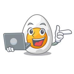With laptop cartoon boiled egg sliced for breakfast