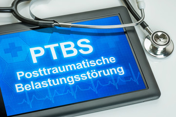 Tablet mit dem Text PTBS auf dem Display