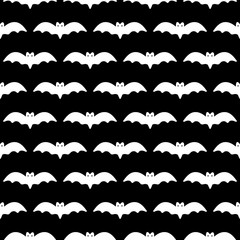 Black and white vector seamless pattern background with bats silhouettes for Halloween design.