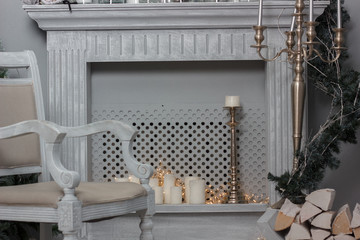 Christmas decoration - room with beautiful chair, fireplace and christmas tree