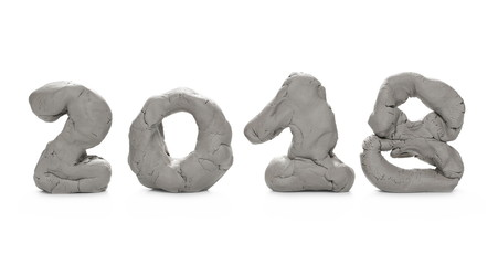 Grey modelling clay in shape of year 2018 isolated on white background