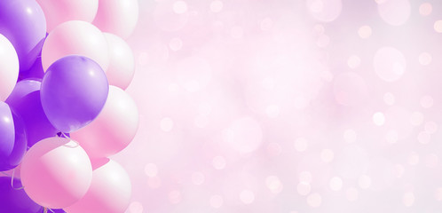 Frame of pastel party balloons on soft background