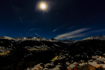 Fototapete - Illuminated Ski Resort of Thyon Les Collons,  in the Night, 4 valleys, Valais canton, Switzerland