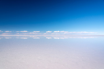 Miror effect and reflection of clouds in Salar de Uyuni (Uyuni salt flats), Potosi, Bolivia, South America