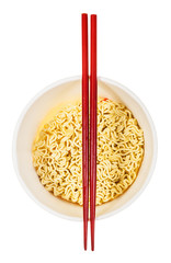red chopsticks on open cup with instant noodles