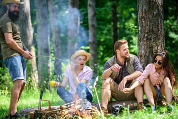 Halt for snack during hiking. Camping and hiking. Company friends relaxing and having snack picnic nature background. Great weekend in nature. Company hikers relaxing at picnic forest background