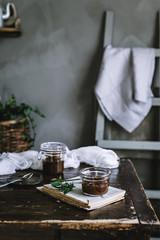 bowl of caramel sauce near jar