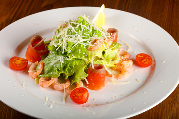 Recess Fitting Appetizer Caesar salad with shrimps and salmon