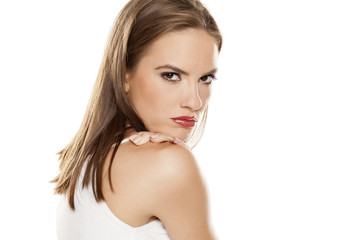 Beautiful angry girl posing on white background