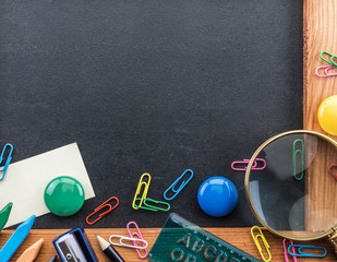 Blackboard and different school things. Close up.