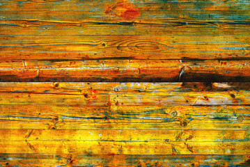 Wall Mural - Yellow weather worn wooden planks surface as background