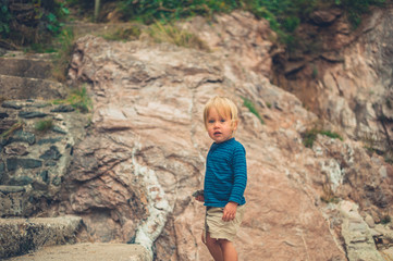 Little toddler by a cliff