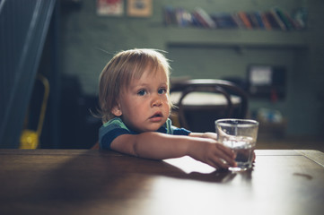 Little toddler at table in cafe