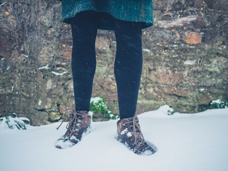Feet of young woman in snow