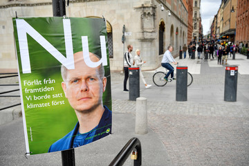 A fake election poster by environmental organisation Greenpeace shows a picture of Green Party leader Gustav Fridolin, in central Stockholm