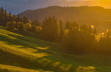 Gold mist in the mountains. Colorful background. Summer sunset in the Western Caucasus.